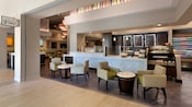 Tables, upholstered chairs and the snack-packed coffee counter at the Wyndham Hotel's Blend café