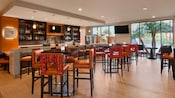 Modern high-backed bar stools and tables at the Wyndham Hotel's Trinitas Wine Bar in Anaheim