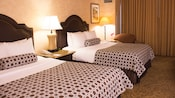 A standard room at the Wyndham Hotel features two queen-size beds, end tables, lamps and a chair
