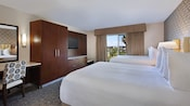 2 queen beds, curtained balcony, built-in wooden armoire, desk and chair, wall-mounted TV and mirror