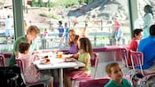 A family of 4 takes a meal break at Flo's V8 Cafe in Disney California Adventure Park