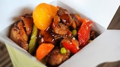 Take-out container with chicken in Mandarin Orange sauce from Lucky Fortune Cookery
