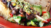 Signature Paradise Garden Grill menu item: beef skewer with vegetables and pita bread