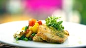 Plate of succulent fish with side vegetables, a specialty on the Wine Country Trattoria menu