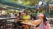 A family of 4 delights in dining outdoors at French Market