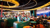 Inside Redd Rockett's Pizza Port, Guests sits at tables and booths and savor tasty meals