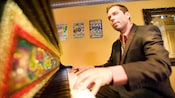 A jazz pianist performs at Ralph Brennan's Jazz Kitchen