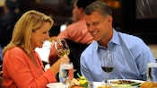 A couple shares laughs over wine and good food at Steakhouse 55