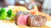 A sliced, seared Steakhouse 55 steak reveals its succulent marble texture