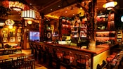 Inside Trader Sam's Enchanted Tiki Bar, find tiki carvings and plenty of treasures and trinkets