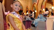 A young princess poses for the camera at Bibbidi Bobbidi Boutique