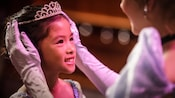 A girl receives the crowning touch at Bibbidi Bobbidi Boutique: a tiara