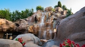 A waterfall cascading down rocks outside the 'O Canada!' film attraction at the Canada Pavilion