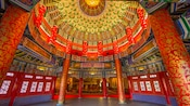 Inside the ornate rotunda with a high ceiling at the Temple of Heaven at the China Pavilion