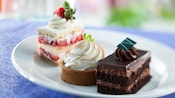 Strawberry shortcake, key lime pie and chocolate mousse cake on a plate