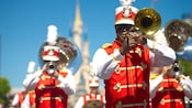 Members of the Main Street Philharmonic band perform while parading on Main Street, U.S.A.