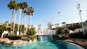 Palm trees, walkway and windmill over Stormalong Bay at Disney's Beach Club Resort