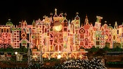 "Thousands of holiday lights illuminate the exterior of ""it's a small world"" at Disneyland"