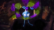 An upside-down Flik gazes down from a tree-roots ceiling at It's Tough to be a Bug! show