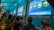 Guests enjoying the interactive queue Soarin' Challenge while waiting to experience Soarin' at Epcot