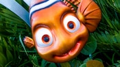A statue of Nemo outside the entrance to The Seas with Nemo & Friends attraction at Epcot