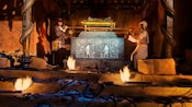 A scene from Raiders of the Lost Ark with Indiana Jones lifting the Ark of the Covenant