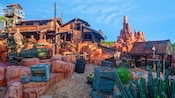 Deserted buildings and boxes in a Western ghost town at Big Thunder Mountain Railroad