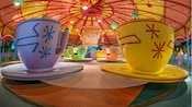 An oversized tea pot and colorful tea cups at the Mad Tea Party attraction in Fantasyland