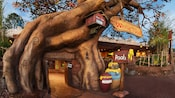 The sign and entrance to Pooh's house at The Many Adventures of Winnie the Pooh attraction