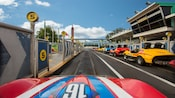 A car drives through the racing pit where the race begins and ends at Tomorrowland Speedway