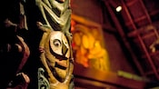 Close-up of a Tiki god carving on a pillar inside Walt Disney's Enchanted Tiki Room