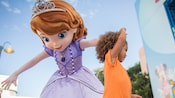 A little girl dances with Sofia in Animation Courtyard at Disney's Hollywood Studios