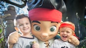 Two boys pose with Jake, leader of the Never Land Pirates