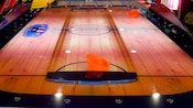 Air hockey table with a wooden table top and 2 strikers