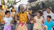A Burudika musician interacts with Guests during a live performance at Disney's Animal Kingdom park