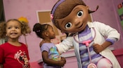 Doc McStuffins next to 2 little girls