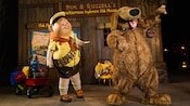 Russell and his dog pal Dug dance in front of their Wilderness Explorers Club House