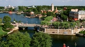 An overview of a section of  World Showcase Lagoon rimmed with international pavilions at Epcot