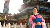 Mulan stands outside the Temple of Heaven at Meet Mulan in China at Epcot