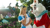 Alice and the White Rabbit look at each other in Fantasyland at Magic Kingdom park