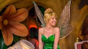 Tinker Bell excitedly looks off to the side