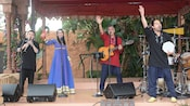 Matboukha Groove performs with instruments on a covered stage