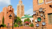 The Morocco Pavilion at Epcot featuring a central open market square surrounded by Moorish style buildings and towers