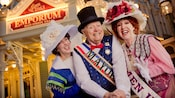 Acting troupe members dressed in 19th-century outfits portray a mayor, a socialite and a suffragette