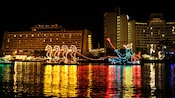 A light display of 4 seahorses pulling King Neptune at the Electrical Water Pageant