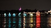Several floats in Electrical Water Pageant with a sea serpent, whale, turtle and an octopus