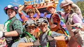 Six of Peter Pan's Lost Boys strike a pose in front of Captain Hook's Jolly Roger Ship