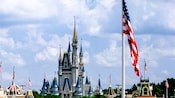 View of Cinderella Castle with an American flag in the foreground