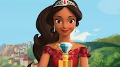 An animated portrait of Elena of Avalor wearing her crown and clasping her jeweled staff