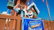 Kristoff and Olaf posing beside a banner for The Frozen Games at Disney's Blizzard Beach water park